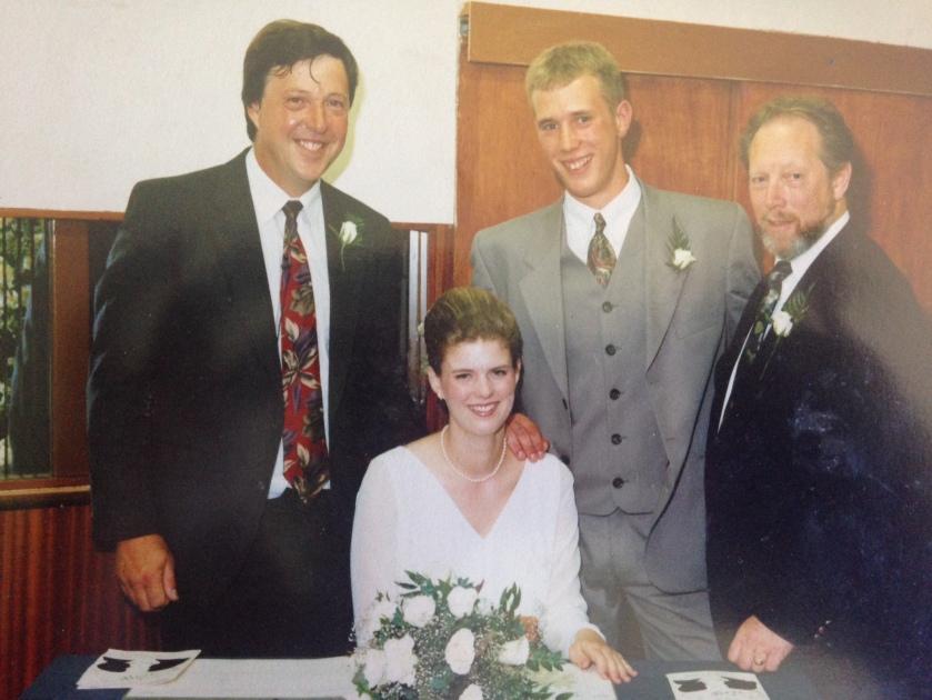 Men signing wedding